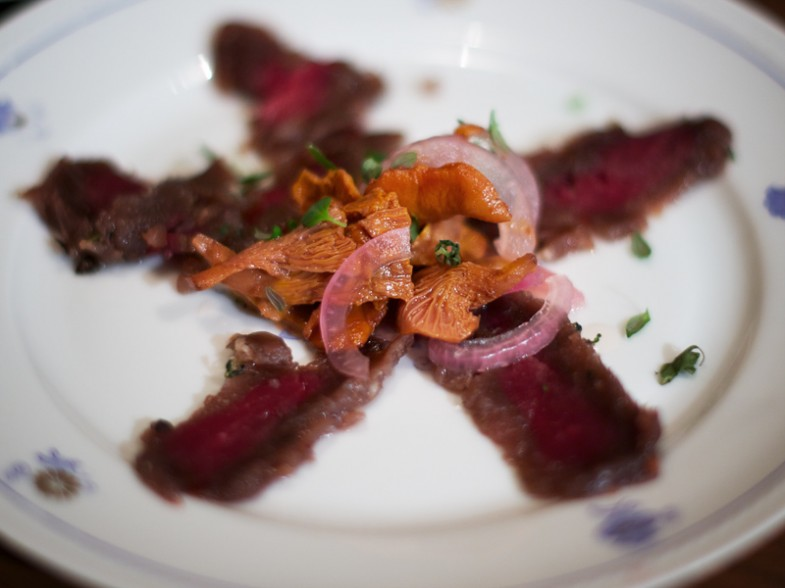Cured fallow deer tenderloin with pickled chanterelles